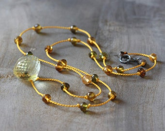 Hand knotted silk necklace - petro tourmaline beads & a lemon quartz briolette with an oxidized sterling silver clasp