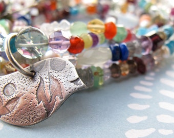 long gemstone necklace with peace dove by modern bird semi precious faceted stones layering