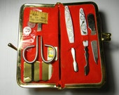 Vintage travel kit, sewing and manicure in red case