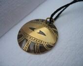 Riven eyeball pendant in domed brass