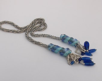 Blue glass slider bead and silver seed bead lariat style rope necklace