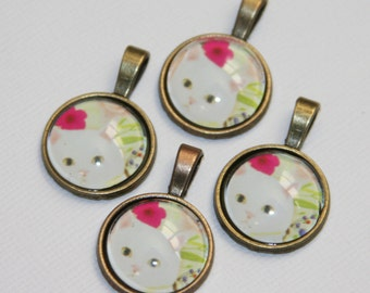 4 pcs of Kitty picture cabochon with antique brass setting 28x18mm