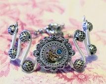 Steampunk Jewelry - Bracelet - antique watch movement and dark aqua swarovski crystal - Silver tone