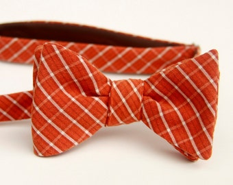 Rust and white plaid freestyle bow tie