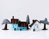Pastel Blue Cabins with trees. Miniature.