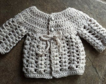 Crochet baby girl cardigan oatmeal with pearl button top size 0 to 3 mo.