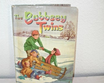 The Bobbsey Twins 1950 book with picture cover - family snow - sledding scene - illustrated vintage childrens book - mid century read
