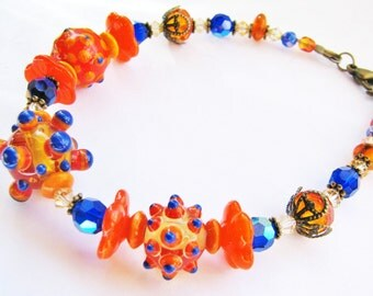 SALE 30% OFF, Bright Orange Lampwork Bracelet, Big Bumpy Beads, Cobalt Blue Crystals, Antiqued Brass, Charms, Gift Ready To Ship