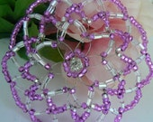 Gorgeous and delicate beaded kippah in shades of purple, clear glass beads and a small sparkly bead in the center