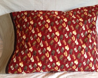 Cowboy Hats on burgundy background Pillowcase