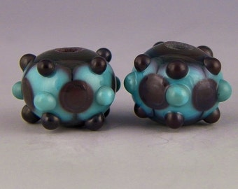 matched earring set in turquoise & dark brown with patterns and raised dots handmade lampwork glass beads - Blue Beans