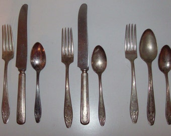 9 Matched Silver Plate Knives, Forks, and Spoons by Rogers