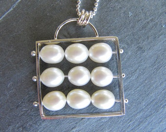 Kinetic Abacus Necklace of White or Peach Pearls and Sterling Silver