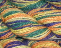 Wool Yarn, Purple, Green, Orange, and Yellow. Hand Painted, Hand Dyed, Handspun Worsted Weight. For socks, slippers, hats, mittens. 120 yds