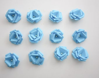 12 Light Blue Mini Paper Rosettes With A Faux Pearl Center