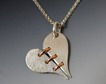 Get Even- sterling silver and gold broken heart necklace