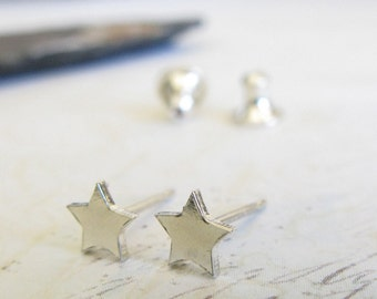 Super tiny star stud earrings. Sterling silver, 14k gold filled or solid 14k gold. Artisan superstar posts. Minimalist. Textured or smooth.