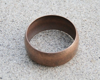Textured copper bangle.