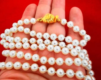 "Vintage 31"" necklace with hand knotted white pearls in great condition,appears unworn"