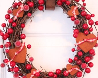 10 inch grapevine wreath with red berries and cinnamon heart ornaments and gingham ribbon