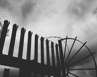 Steel Fence Silhouette Against Dark Cloudscape - Monochrome Industrial Fine Art Photograph - Gallery Quality Signed Limited Edition Prints