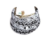 Feather String Cuff in White on Black