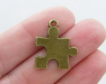 8 Puzzle piece pendants antique bronze tone BC23