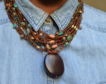 Necklace Multi-strand Amber beads and Sea Bean Pendant with Earrings