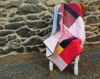 Patchwork crib quilt / baby blanket