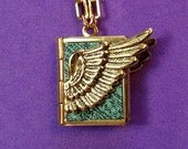 Winged Love Locket- turquoise and gold, holding 14 ways to tell someone you love them, from English to American Sign Language.