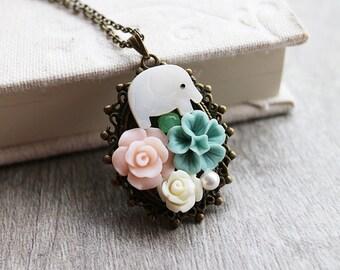 Elephant in Flower Necklace. white elephant with flower necklace. garden necklace. girl necklace