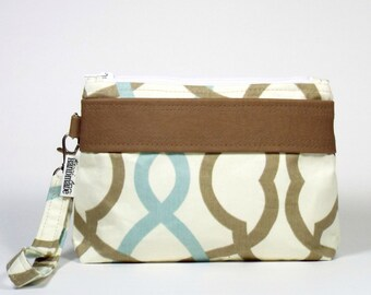 The Lia Faux Leather Trim Wristlet  Waves Latte