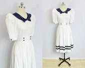 White and navy sailor dress