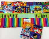 School Time Crayon Tote in a colorful print complete with 12 crayons and a paper pad