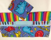 Zoo Time Crayon Tote in a colorful print complete with 12 crayons and a paper pad