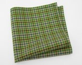 Men's Pocket Square in a plaid of bright green, navy blue, spicy yellow, and ecru