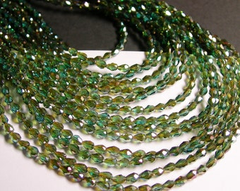 Faceted teardrop crystal beads - 100 pcs - 3mm x 5mm - sparkle fire emerald - CLGD10