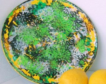 Painted wood plate decorative  reuse vegan Earth friendly green black yellow white layered over flower stamp design