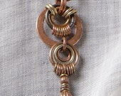 Zero Hour necklace: hammered copper washer pendant, mixed metal rings, leather