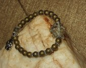 Golden India Glass Fish Stretch Bracelet with Gold Frosted Hematite Beads and Daisy Spacers & Charm
