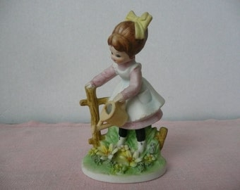 Porcelain Figurine of Little Girl Watering Flowers - Made in Japan
