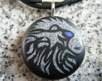 Zodiac LEO hand carved on a polymer clay black color background. Pendant comes with a FREE 3mm necklace.