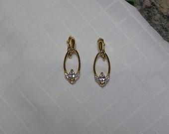 Vintage Trifari gold loops marquis cut rhinestone flower clip earrings