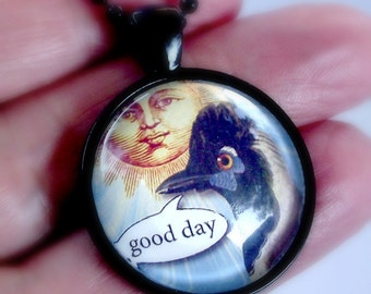 SALE. Good day pendant. Australian talking bird and sunny day necklace. Black frame and chain. Greetings phrase