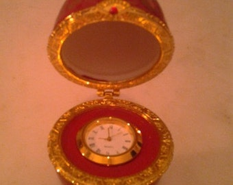 Exquisite Parisian Ruby Jeweled Clock in Porcelain Gilded Egg