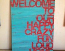 welcome to our...home. red and turquoise. 12 x 16  hand painted canvas sign.