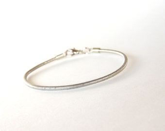 Guitar String Bracelet - silver bass string - unisex - for teens and adults - recycled/eco-friendly/upcycled jewelry - under 20.00