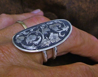 Engraved sterling silver saddle ring