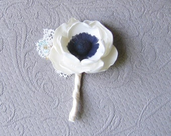 Fabric flower boutonniere to match wedding package . White anemone with dark center . Swarovsky crystal spray and lace leaves