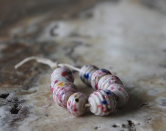 lampwork bead set of nine ribbed pink with multicolor speckles